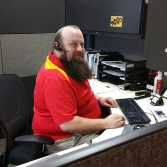 John White at Desk